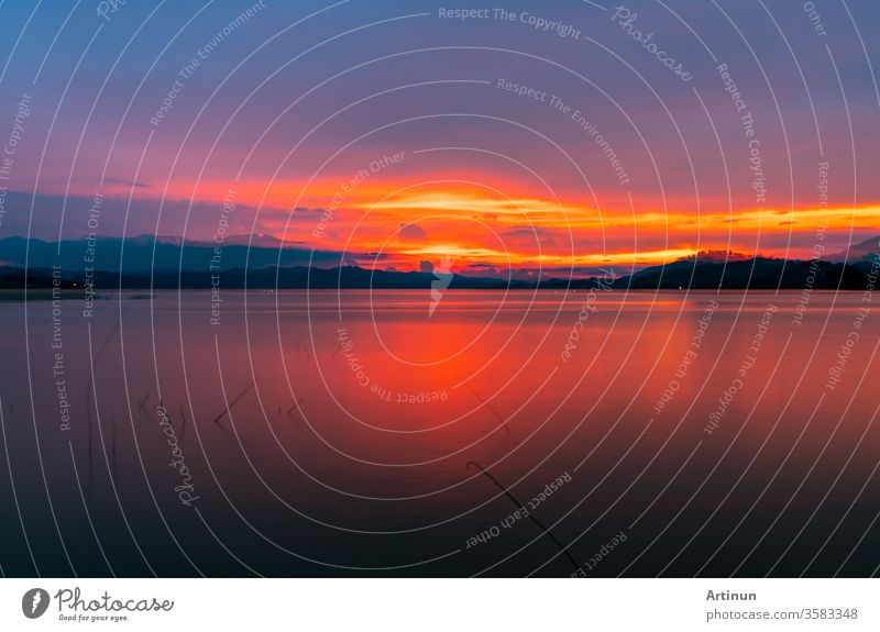 Red and orange sunset sky at the mountain and lake. Beautiful evening sky. Majestic sunset sky. Nature background. abstract amazing awesome backdrop beautiful