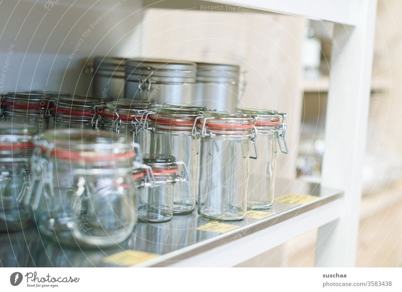 empty preserving jars on a shelf Glass rubber ring Wired ironed glass Empty Shopping without plastic unpacked Shelves Load shank Food ecologic sustainability