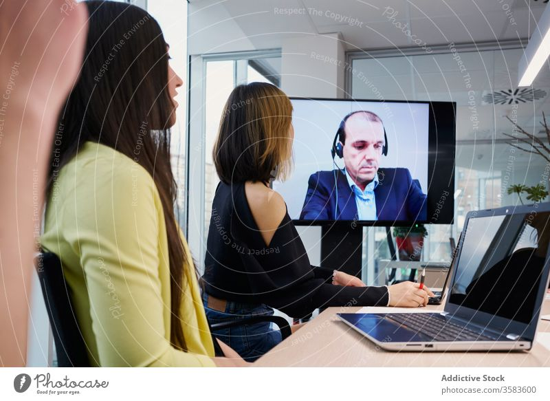 Colleagues participating in video conference colleague coworker video call meeting online together workplace group young casual partner modern communicate