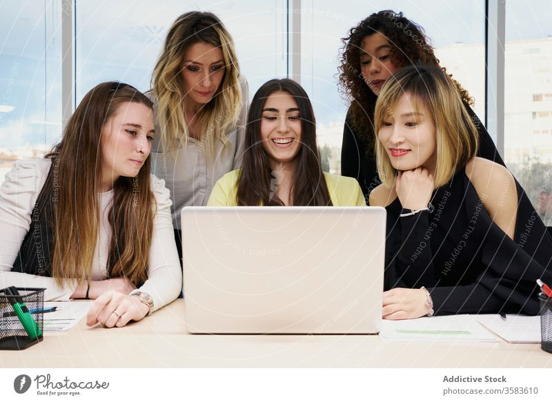 Young women with laptop working together in office colleague coworker using workplace group business watch young multiracial multiethnic diverse asian female