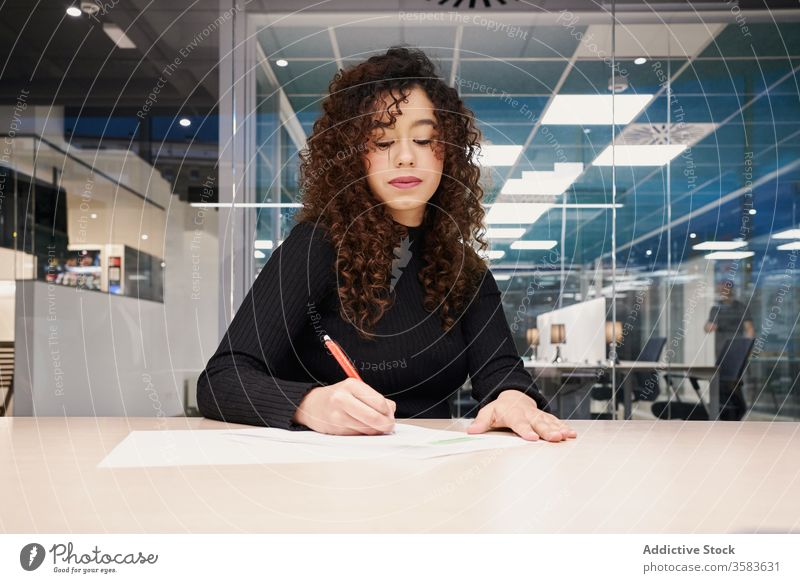 Modern busy woman making notes in document work workspace take note young entrepreneur businesswoman write serious female paper gadget modern professional job
