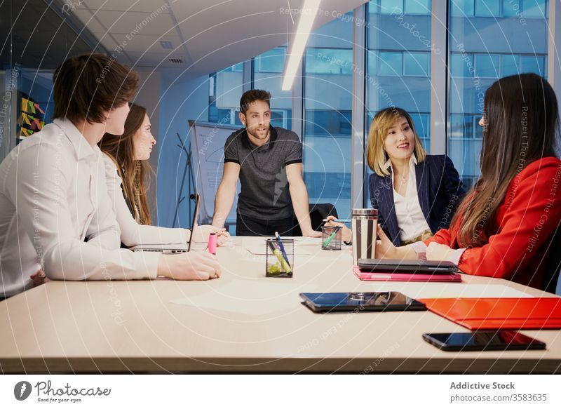 Company of diverse colleagues working together at table businesspeople discuss project gather company coworker office multiracial multiethnic asian meeting