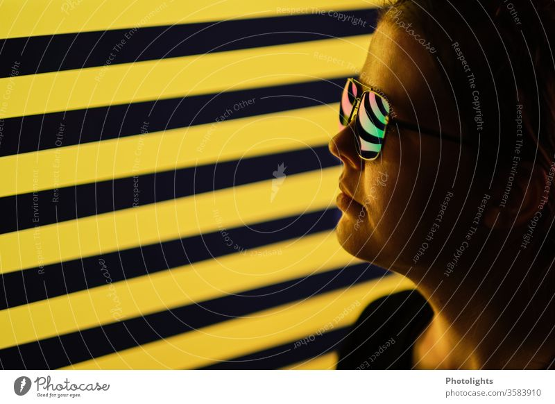 Woman with reflecting glasses in front of black-yellow background Style Black Yellow Nose Profile Facial expression Lips portrait Light Looking Sunglasses
