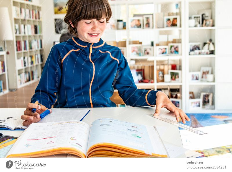 homeschooling | mom is a great teacher Day Colour photo Family pen stay at home Infancy Face Boy (child) Child Close-up Interior shot School Study Sunlight
