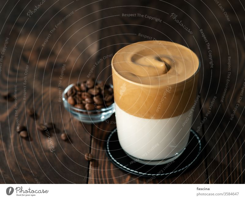 Dalgona coffee, copy space dalgona coffee wooden background whipped glass drink trendy beverage milk brown cup cold cream homemade food dessert delicious sugar
