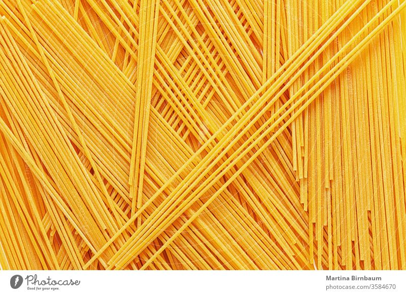 Uncooked spaghetti noodles, flat lay dinner cuisine italian food pasta full frame delicious raw yellow no people grain wheat dried food studio shot strand