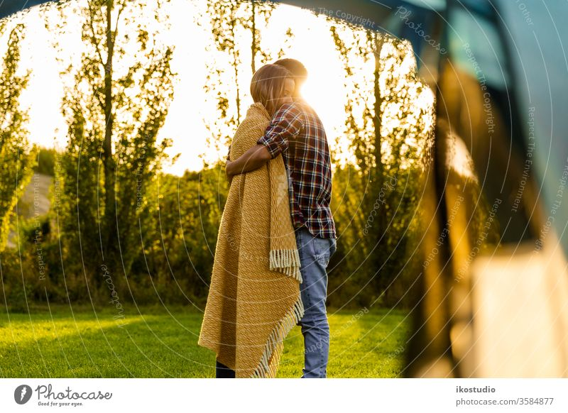 Waking up on a special place couple love hug cuddle relax sunset nature camping tent warm blanket cozy adventure travel friends holidays field boyfriends