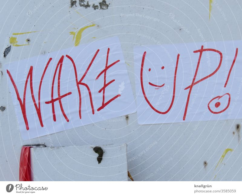 "Two white sheets of paper ""WAKE UP!"" with a smiley face written with a red pen stick to an old white metal door Smiley Graffiti Wake up wake up Exclamation mark"