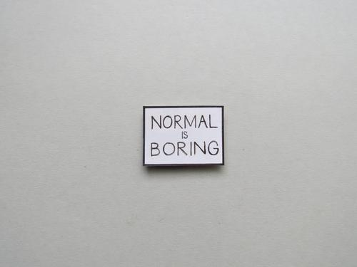 NORMAL IS BORING Boredom Normal Human being Gloomy Emotions boring bored Letters (alphabet) Word leap Characters Close-up communication Language Typography Text
