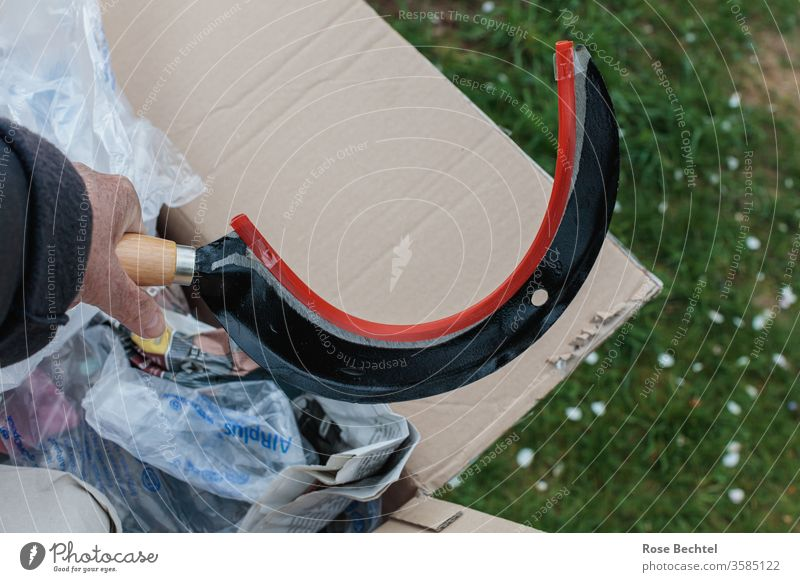 Hand with sickle Package Meadow Packaging Colour photo Deserted Close-up Copy Space top Copy Space right object of desire by hand unwrap