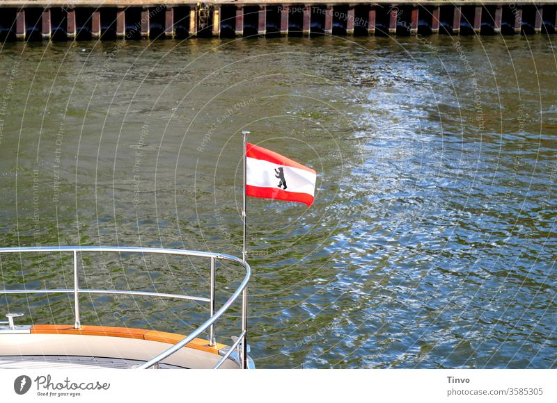 National flag of Berlin bear on the railing of a ship flag of the country Berlin Bear Spree Navigation Tourism quay wall Railing Bow Heraldic animal White Red