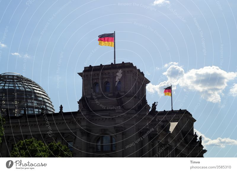 Reichstag Berlin with dome and flags Reichstag dome Reichstag building Government Architecture Capital city German Flag Seat of government Copy Space Tourism