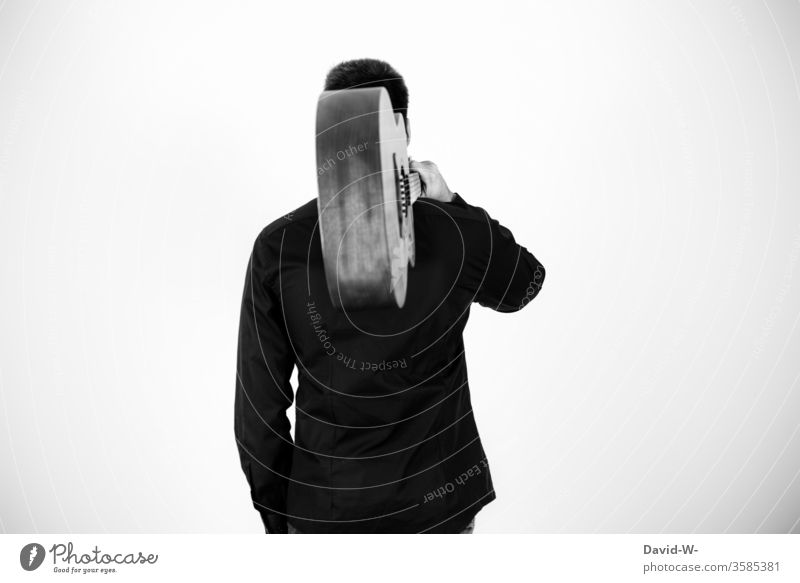 Man carrying a guitar Musician Guitar Concert coronavirus interdiction Artist Black & white photo Anonymous Musical instrument Listen to music time-out Break