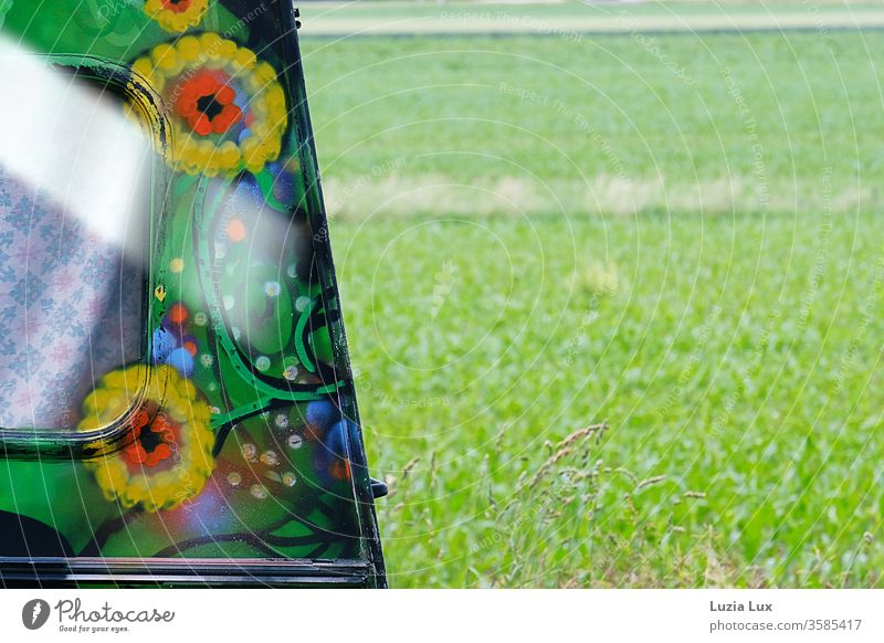 Flowerpower feeling at the roadside, in front of a green meadow in the sunshine Mobile home Old fashioned Hippie Summertime Sunlight Curtain Window Drape