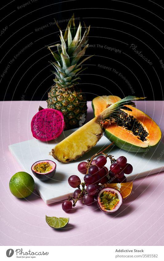 Still life with tropical fruits exotic papaya hawaii ingredients natural organic food pitaya dragon passion green colorful juicy sweet ripe vegetarian