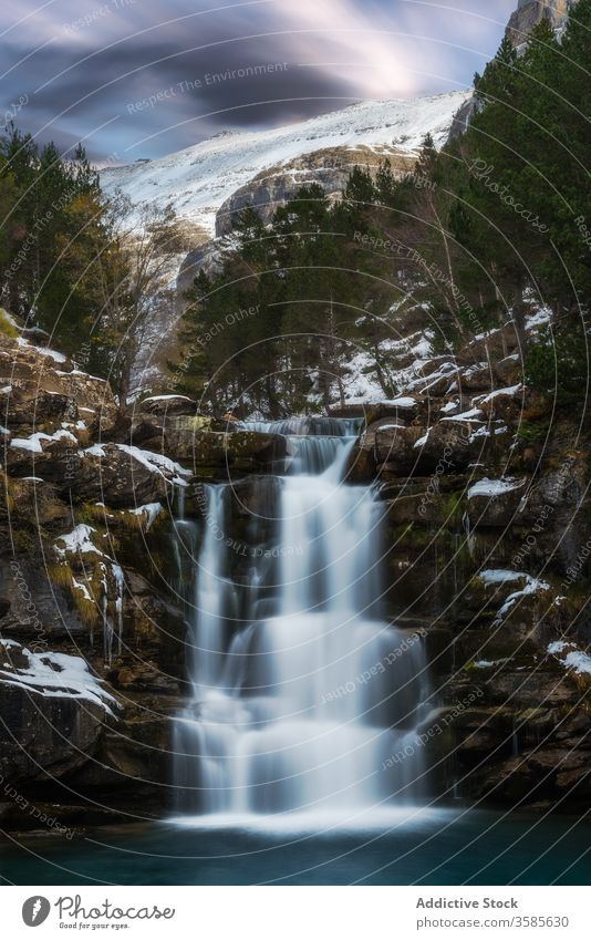 Mountain stream flowing through mountainside landscape waterfall snow cold ice view amazing forest rock incredible winter stone star picturesque dark majestic