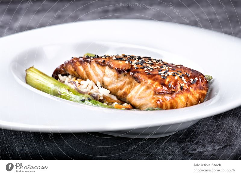 Grilled salmon steak with sesame dish restaurant fish honey vegetable food grill delicious culinary meal serve tasty gourmet fresh organic gastronomy glaze