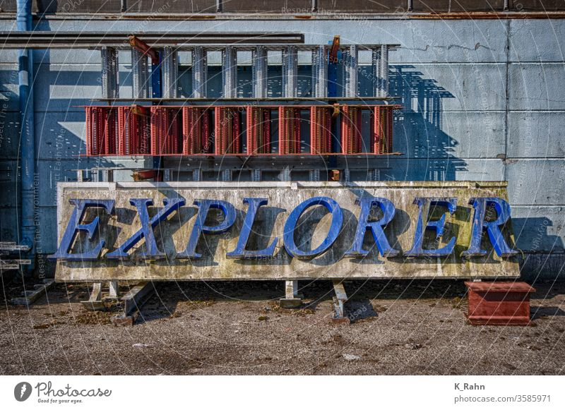An old neon sign explorer Neon sign Letters (alphabet) Word Light aged graphic graphic design Wall (building) Metal Architecture Sign Art Character