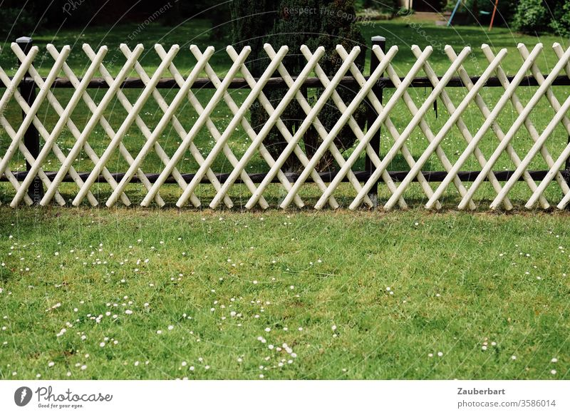 White hunter fence borders and divides a green meadow Fence hunting fence Border Meadow Restrict share Division Pattern rasp Garden Real estate Neighbor Barrier