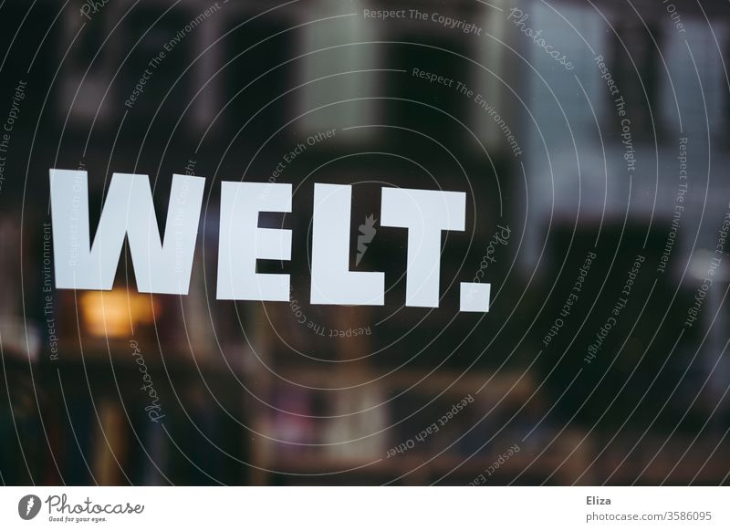 The word world written on a shop window Shop window Word authored Global reflection World Community lettering writing Text shank Rescue