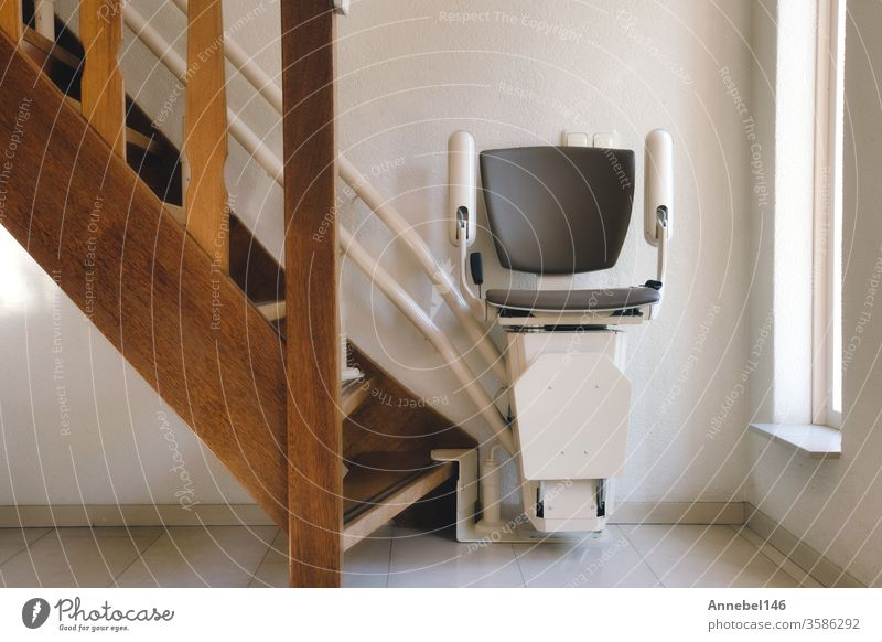 Automatic stairlift on a staircase for elderly or disabled people in a house, Design person House (Residential Structure) 3D Technology Banner handicap