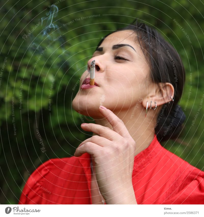 Estila Woman feminine Red Smoking Self-confident Nature Jewellery out Dark-haired Long-haired braid To enjoy enjoyment Cigarette by hand Closed eyes Smoke