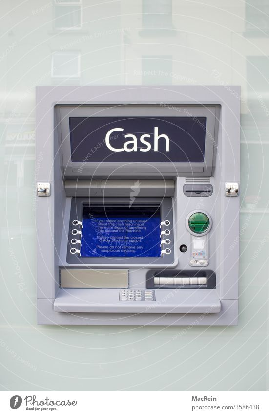 Cash dispenser in the outdoor area Teller machine cash ATM Bank building Bench Exterior shot Keyboard take out money niemnad Copy Space top