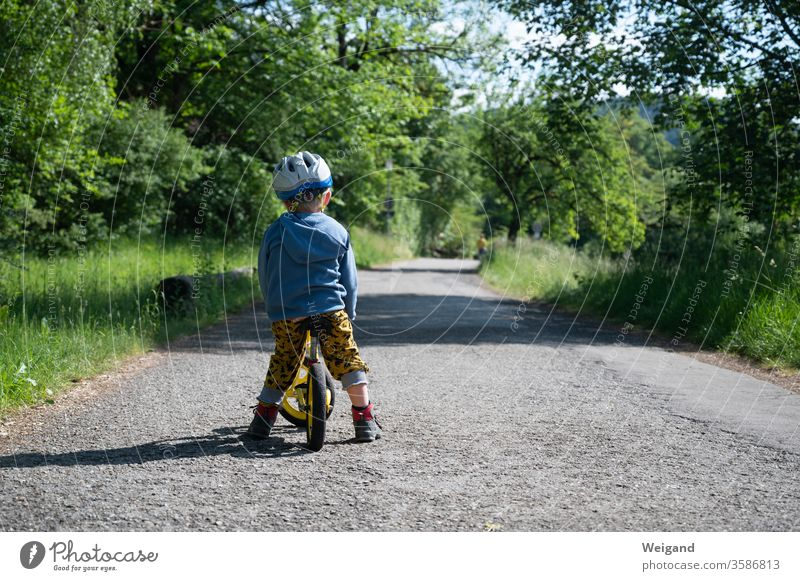 Child with bicycle on a path Lanes & trails Bicycle impeller wax Infancy Study Transport Exterior shot Cycling Day Street Colour photo Driving