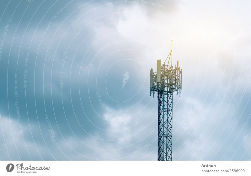 Telecommunication tower with cloudy sky background. Antenna on blue sky. Radio and satellite pole. Communication technology. Telecommunication industry. Mobile or telecom 5g network. Technology