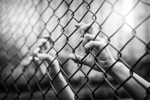 Depressed, trouble and lives matter. Black&White filter, women hand on chain-link fence. barbed barricade barrier black border bullying conflict crime crisis