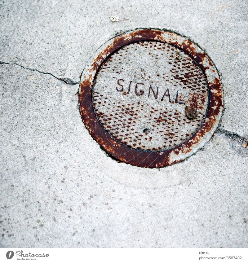 Interfaces of everyday life (6) Iron Round Metal Rust Safety Protection lid Gully Concrete Street Crack & Rip & Tear Signal Letters (alphabet) Word