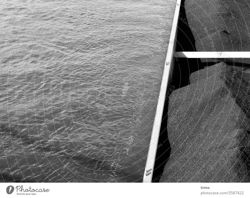 Full of gravel sparkle system relevant Surface Shipping traffic coal Cargo Transport rheinschiffahrt Water River Rhine Metal ship Shadow sunny Transportation