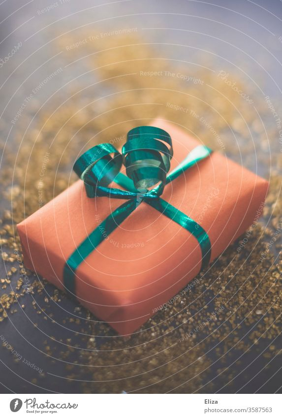Christmas gift on gold Gift Gift wrapping Pink Green Gold Festive Donate Giving of gifts Christmas & Advent Surprise Birthday Packaging ornamental