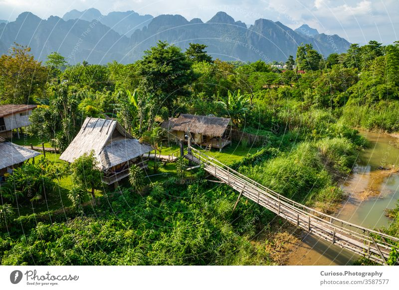 Village and mountain in Vang Vieng, Laos vientiane scenery people thailand luang rice house home lao grass vangvieng riverside rainforest beauty hut jungle
