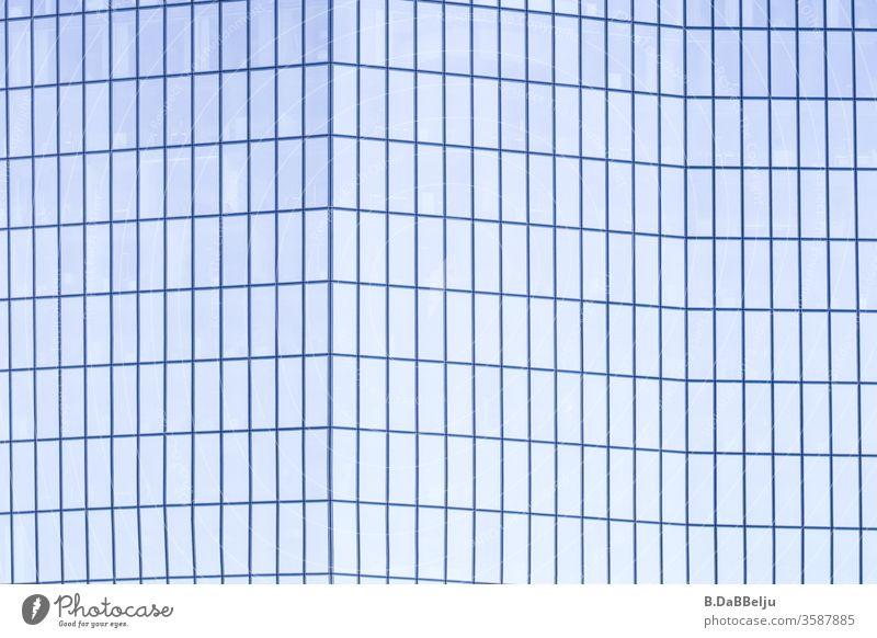 Skyscraper folded in soft blue. Symmetry Blue Modern Deserted Facade Architecture Advancement High-rise Tower built Glass Esthetic Sharp-edged Elegant Success
