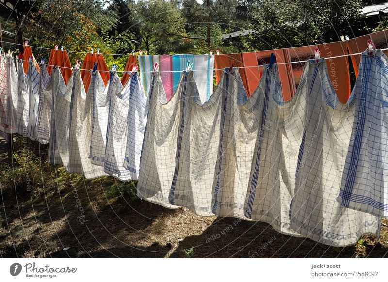 Wash day is before the next wash day Orderliness Design Many Sunlight Shadow Pattern Side by side Dry Cleaning Symmetry Determination clothesline Dish towel