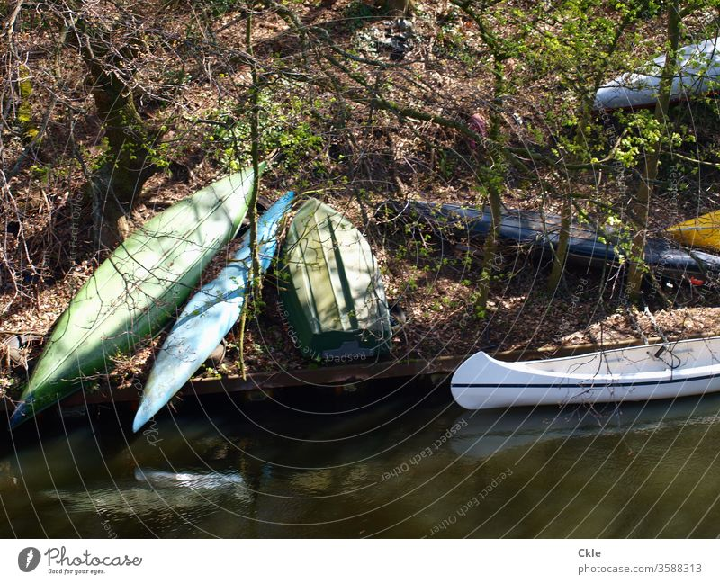 Boat fallow boats Canoes bank steep River decommissioned temporise Parking Nature Trip Adventure Forest free time Sports Landscape Aquatics Exterior shot