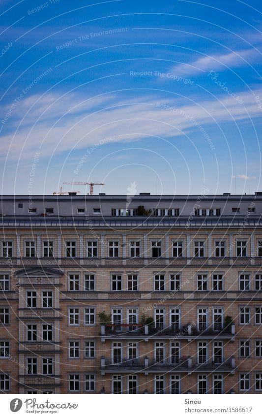 Sky over Berlin Facade House front Apartment house tenement houses Balconies Roof terrace Construction crane Blue sky Clouds Cirrus cloud Summer warm