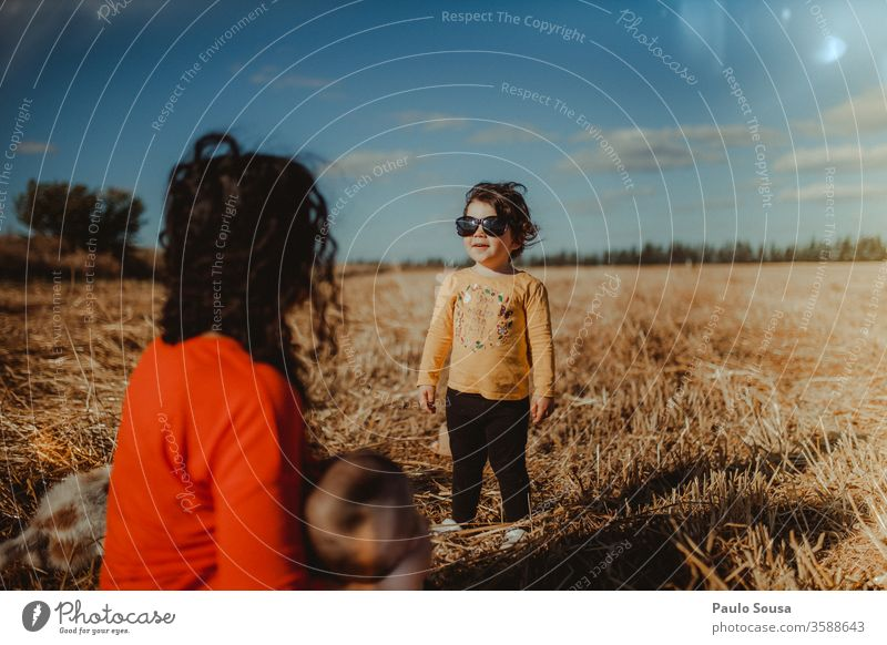Child with sunglasses Sunglasses Summer Summer vacation Day Family & Relations Field Vacation & Travel Human being Nature Playing Boy (child) Colour photo
