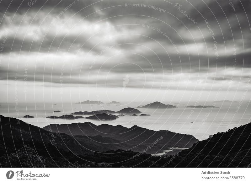 Remote mountains under cloudy sky shore tropical china hong kong environment landscape seascape ocean tranquil bay scenic idyllic mist scenery beach asia