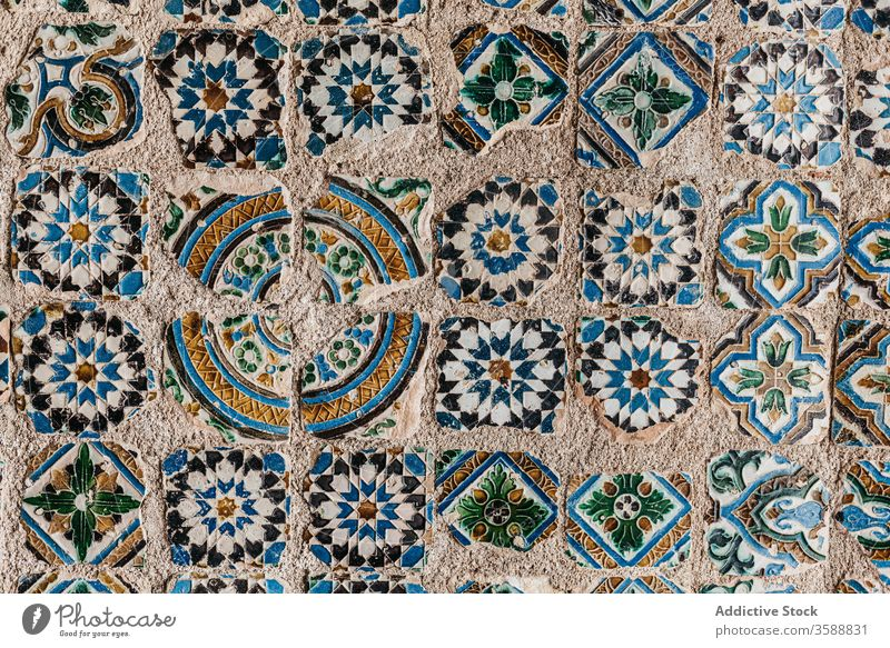 Pattern of colorful mosaic tiles background stone surface ornament weathered city texture old lisbon portugal shabby pattern element detail aged decor grunge