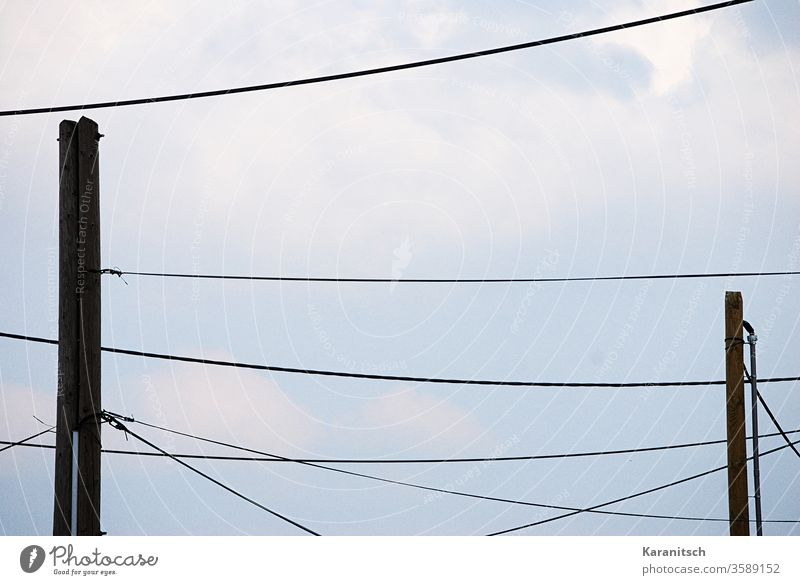 Many power lines draw a pattern in the sky. Sky Blue Clouds cloudy Cable Cables Power lines Tense fat Power poles fixed hang stream Energy Deliver