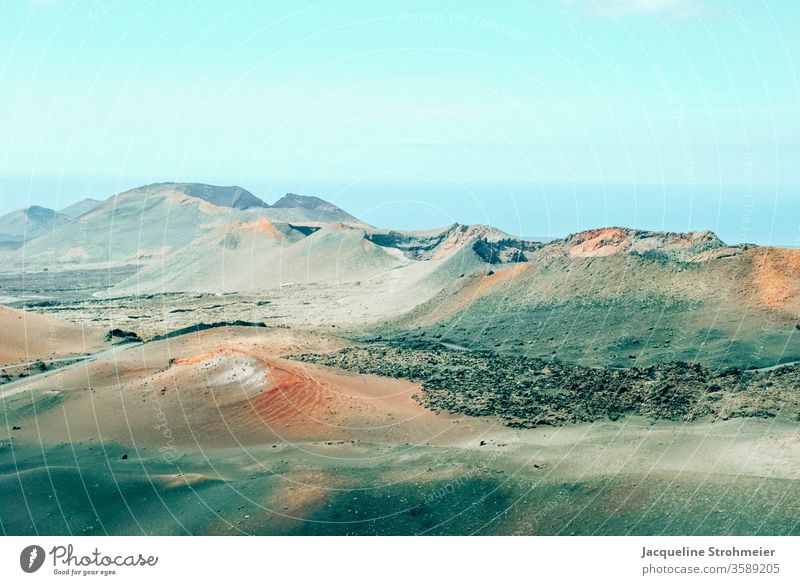 Montañas del Fuego, Timanfaya National Park, Lanzarote, Spain Geology Trip Deserted Rock formations Black landscape Travel photography Clouds volcanoes