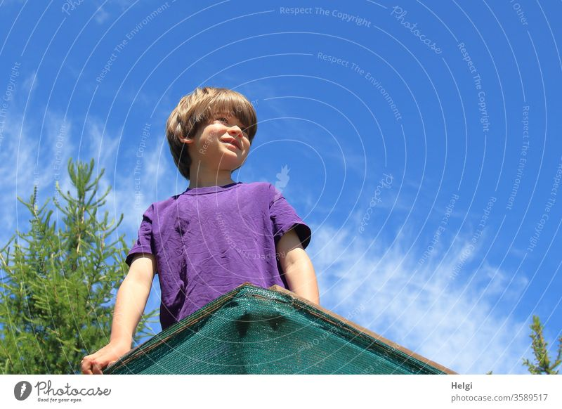 high up - child stands on a high seat in a clearing and looks into the distance | favourite person Human being Child portrait lookout Hunting Blind smile Joy