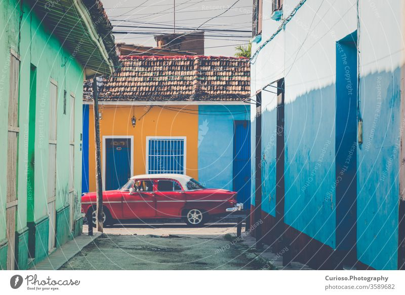 Colorful houses and vintage cars in Trinidad, Cuba. Unesco World Heritage Site. america antique architecture attraction beautiful building caribbean city