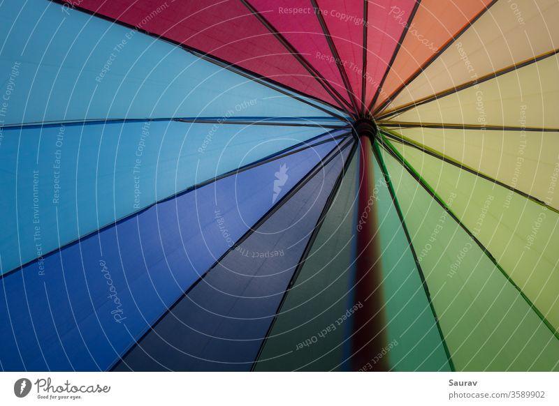 A Rainbow color Umbrella. Colors that also represent LGBT pride flag and equality. colorful rainbow umbrella vibgyor black lives matter gay pride flag