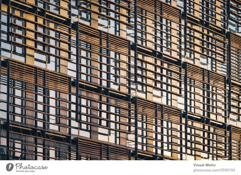 Geometric facade of a minimalist building under the last afternoon lights abstract abstract background abstract photography apartment architectonic
