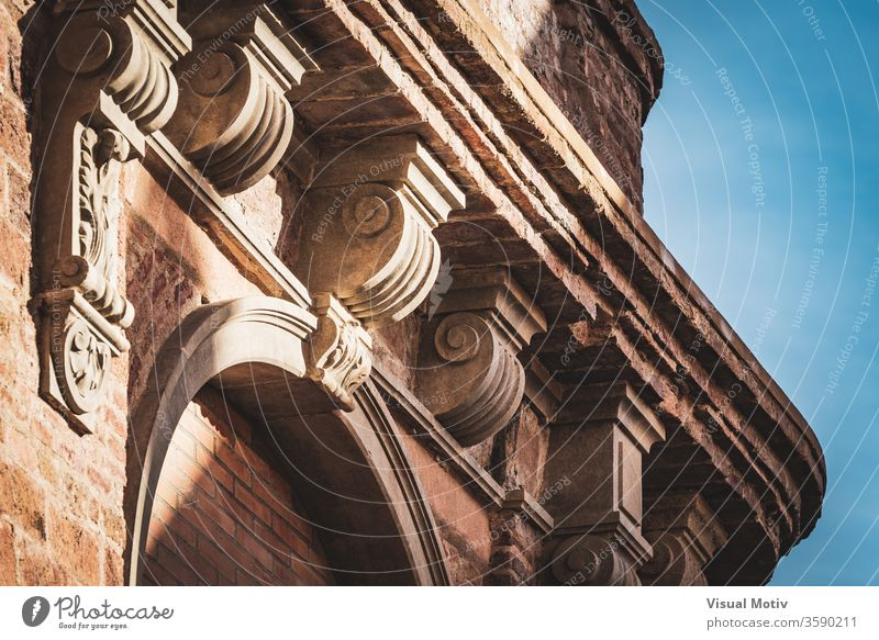 Neoclassical capital on the cornice of an old red brick building neoclassical facade ancient architecture ornamental authentic century heritage civilization