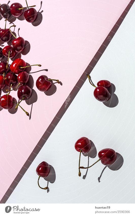 Fresh seasonal red cherries in strong sunlight fruit background fresh food white raw organic dessert delicious healthy vegetarian freshness nature top summer