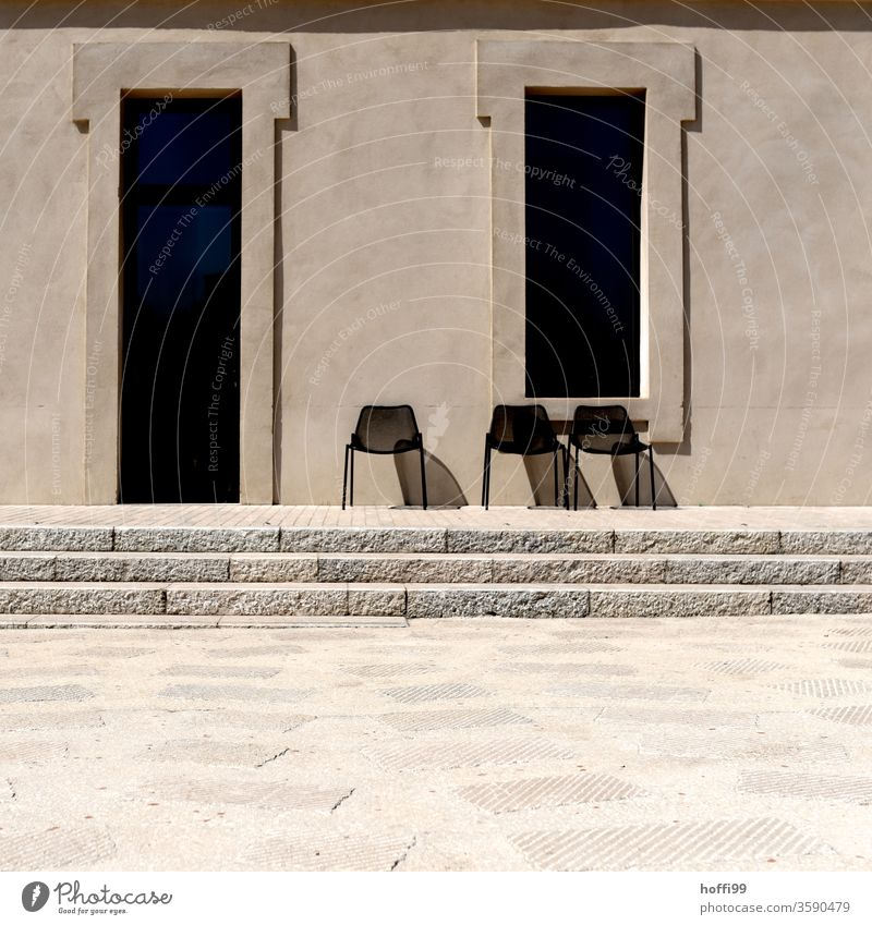 Three chairs in the sun are waiting for guests three Chair Group of chairs Row of chairs sandstone wall Wall (building) Sandstone Facade Stone wall Arrangement